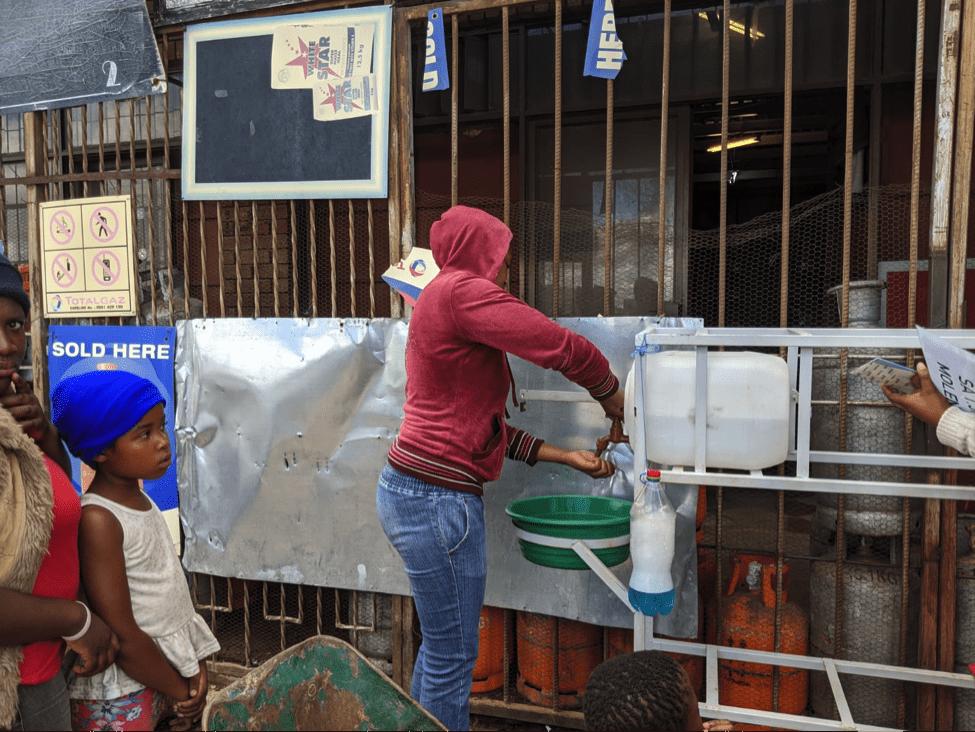 Community member using Hand Wash Station